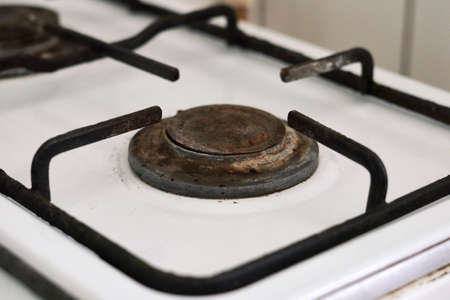 An old grungy gas stove. Old gas burner. No gas, Winter and cold period