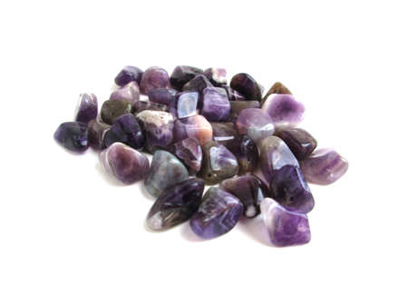Semi-precious amethyst on a white background. For jewelry with their own hands. Archivio Fotografico