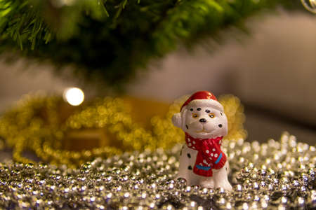 Toy dog under the Christmas tree, symbol of the year 2018 according to the Chinese calendar
