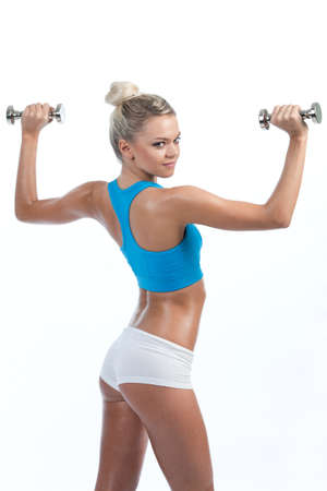 Fitness - a strong beautiful girl