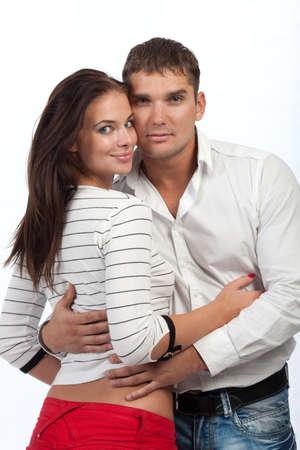 Sexy young couple hug isolated on white studio background photo