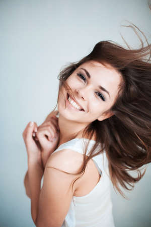 dishevelled: The beautiful young girl happily laughs