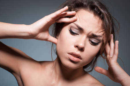 eyes looking down: the woman with a headache. Stock Photo