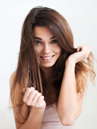 dishevelled: the beautiful laughing girl with long hair.