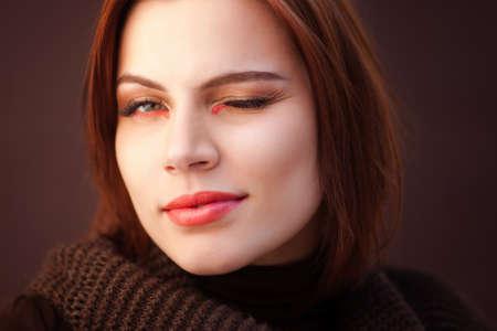 The beautiful woman winks photo