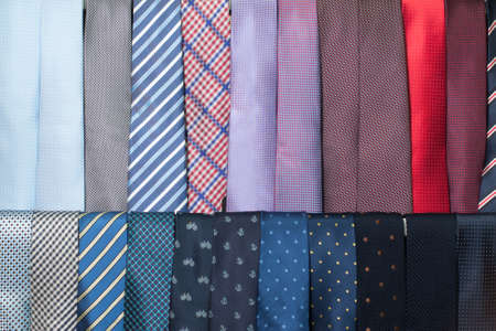 showwindow: It is a lot of different multi-colored ties on a show-window Stock Photo