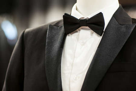 Wedding black tuxedo and bow tie on the unrecognizable person