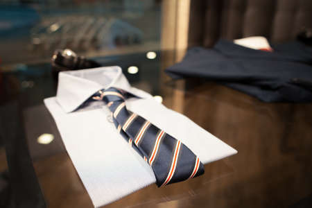 showwindow: Set of new clothes: a shirt and a tie which lie on a glass show-window Stock Photo