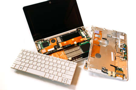 repair computer: Disassembled broken netbook (laptop). The isolated image on a white background Stock Photo