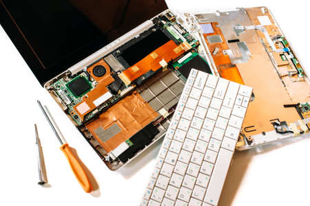 Repair set of the disassembled broken computer (laptop). The isolated image on a white background