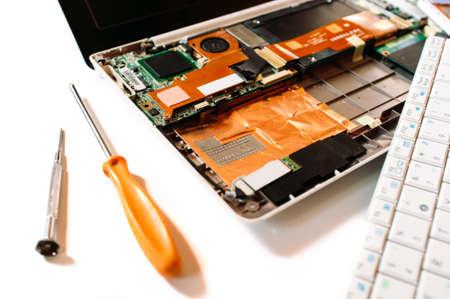 disassembled: Closeup photo of the disassembled broken computer (laptop). Repair set Stock Photo