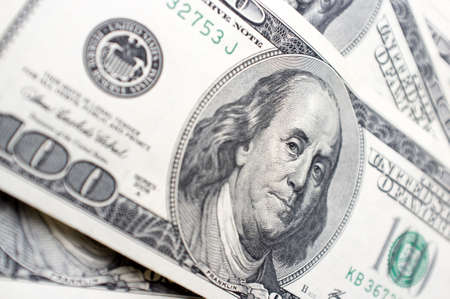 one hundred dollar bill: It is a lot of 100 dollar bills with Benjamin Franklins face