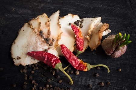 salo: Salo with spices,garlic  and red pepper on the dark wooden background