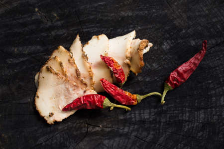 salo: Salo with spices and red pepper on the dark wooden background
