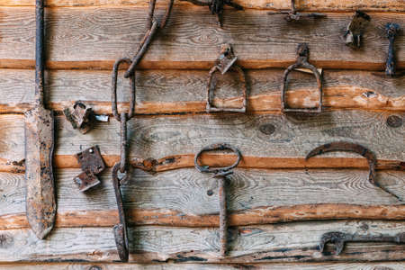 archeology: set of old rusty  objects on a wooden background. A concept on excavation, archeology, farming, the Ukrainian culture themes