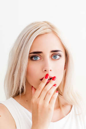 eyes wide open: Surprised upset girl covers her mouth and her eyes wide open. A conceptual photo on a white background