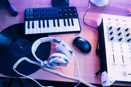 musical staff: Audio production in sound studio with musical equipment. DJs musical staff