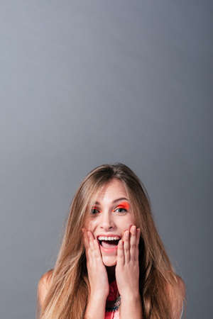 junge nackte m�dchen: Sweet girl is really very happy and she expressing emotions. Studio photo on a gray background with a lot of free space.