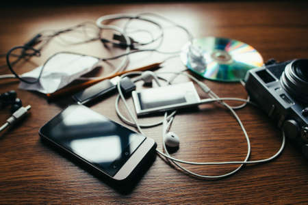 distraction: Concept of chaos in the home desktop with mess of disorder objects