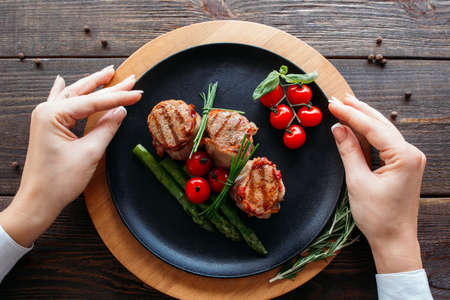 food photography: Food photography of grilled pork medallion with fresh vegetables.  Top view of french cuisine from chief. Delicious grilled pork medallion with vegetables.