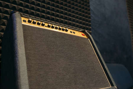 amplify: Electric guitar amplifier closep with free spce. Black professional guitar amplifier