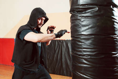 self defence: Boxing Man Sport Training Punching bag Fight Lifestyle Gym Self Defence Concept