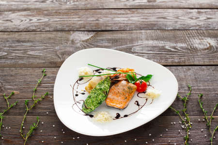 Mussle, grilled salmon, shrimp on wood copyspace. White plate with variety of seafood on wooden background. Free space and seafood mix plate. Stock Photo