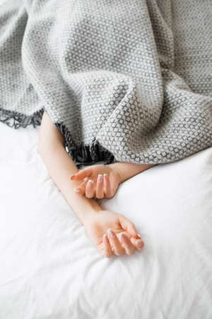 protruding: Bed Hands Protruding Blanket Woman Covered Sleeping Fatigue Loneliness Isolation Introvert Concept Stock Photo