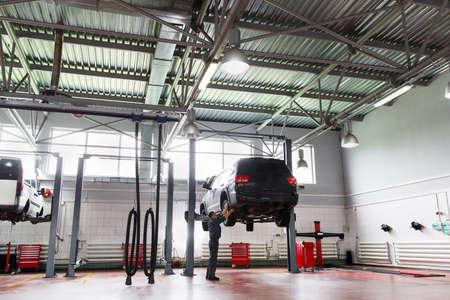 auto hoist: Maintenance Mechanic Car Transport Garage Professional Service Workshop Repair Business Concept Stock Photo