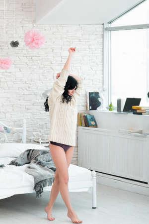 awakening: Woman Brunette Step Tiptoe Morning Pullover Barefoot Awakening Bedroom Concept Stock Photo