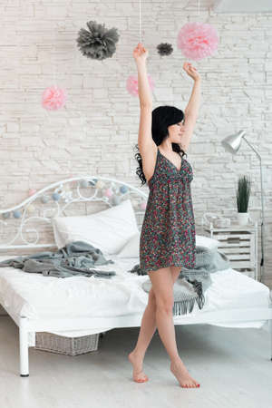 awaking: Woman Brunette Stretching Tiptoe Awaking Barefoot Bedroom Morning Concept Stock Photo