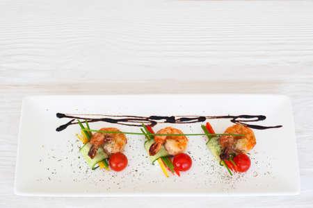 dinner menu: Fried shrimps restaurant serving flat lay, copyspace on white wooden background, horizontal orientation
