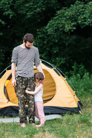 free space: Shy girl with dad, travel photo, free space. Family trip, camping, pastime together concept