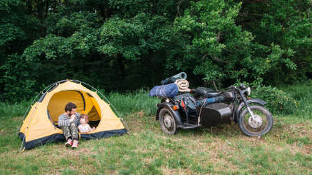 sidecar: Father and daughter travel on motorbike to camping. Sidecar motorcycle trip with dad, free space