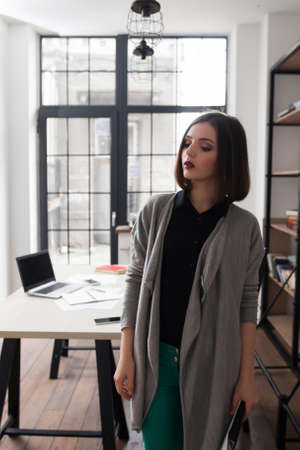 modernization: Attractive business woman, standing in office. City life, occupation, modernization concept