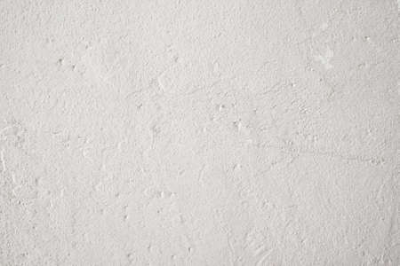 backdrop grungy: Grungy gray background, free space. Old uneven white wall backdrop Stock Photo