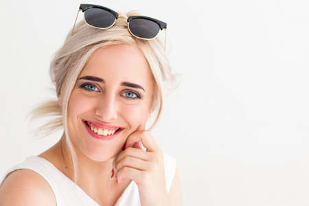 bad teeth: Pretty girl with creepy smile close-up. Attractive blonde woman in sunglasses with bad teeth, dentistry problems.