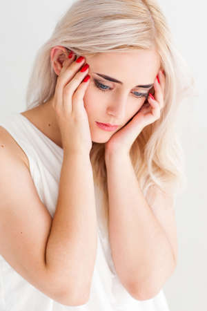 megrim: Strong migraine concept. Poor beautiful blonde woman with severe headache, close-up on white background