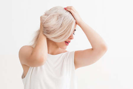 bad hair: Blonde girl with bad hair. Bad condition of dyed hair, health and beauty concept Stock Photo