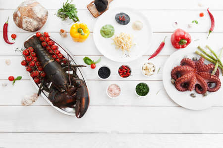 food products: Ingredients for cooking, raw food, flat lay. Top view on products, prepared for making mediterranean meal, white wooden background. Italian cuisine, culinary classes, restaurant kitchen concept Stock Photo
