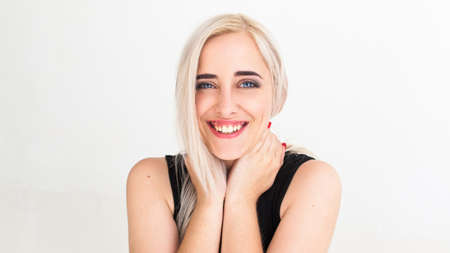 widely: Widely smiling at camera pretty blonde. Lovely woman with strange smile hugging her neck and laughing, Happiness, fun, frivolity