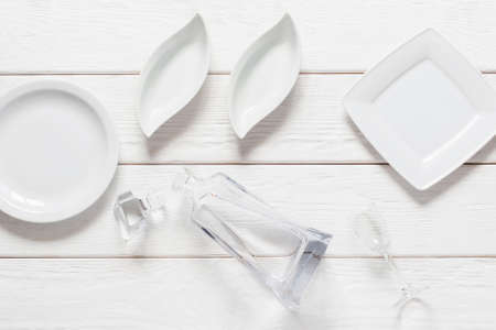 void: Empty plates on white background, void, flat lay. Mockup for any cuisine meals, snacks for vodka concept