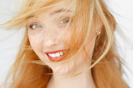 disheveled: Amazedly smiling red-haired girl portrait. Attractive woman with disheveled hair. Happy morning face portrait