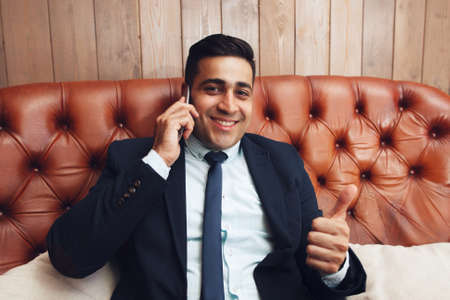 free space: Businessman with thumb up hand sign, free space. Successful business problems solving. Feeling like, satisfaction concept.