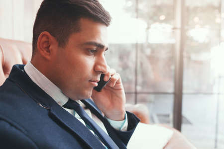 Close up of businessman talking on phone. Negotiation. Communication with partners. Stock Photo