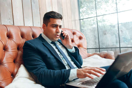 means: Man conducting negotiations on the web. Telecommunications concept. Means of communication and business. Stock Photo
