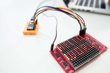 LED matrix display with words hello world. Electronic components for construction on white background, close-up. Technology, hobby, invention concept