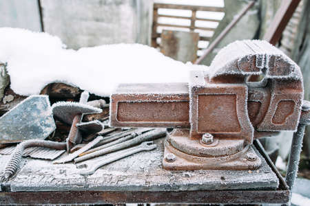 holdfast: Frosted vise tool in outside workshop. Left outside tools in winter. Cold, early frosts, hoar concept