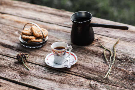 lonelyness: Coffee with cookies on wooden table, free space. Traditional coffee break with pastry, rustic style. Autumn, warming drink concept Stock Photo