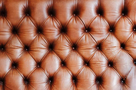 Genuine leather upholstery rich background. Leather furniture texture in brown tones. Luxury lifestyle concept Stock Photo